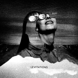 "B/W cover of Levitations ""Dust"" LP showing a women's face with sunglasses, smiling to the sun."
