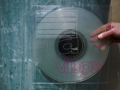 "Picture of a hand, holding the first press of the Villages ""ILL AGES"" LP in front of a blue barrel"