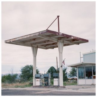 Cover of the Phantom Pain S/T LP showing an abandoned gas station in the middle of nowhere.