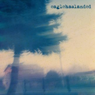 "Cover of the Eaglehaslanded S/T 7"" showing a blurry picture of a tree w/ a fence or buildings in the background. Color Schema is blue / red."