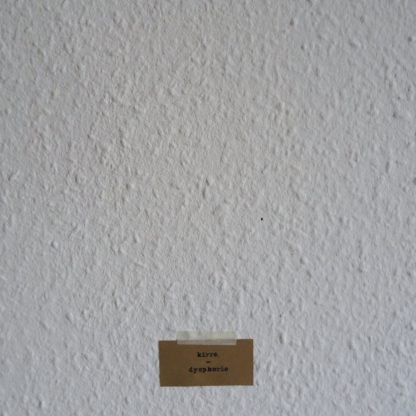 "Cover of the kirre. ""Dysphorie"" EP showing a small piece of cardboard holding the band name and album title. It's taped to a wall with ingrain wallpaper."