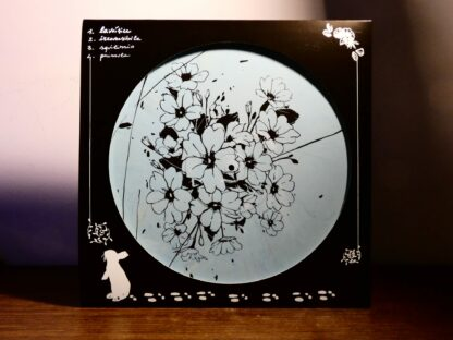 """Photo of the Chivàla """"II"""" EP B-Side Screen Print showing a bunch of flowers. Black print on white blue marbled vinyl."""